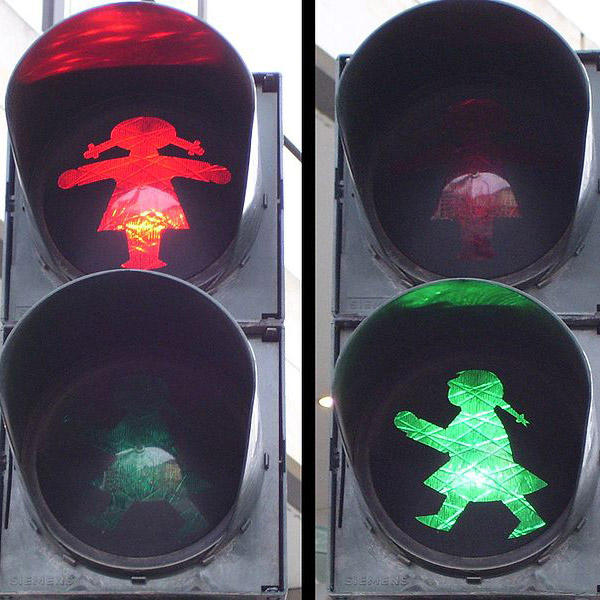 An Ampelmädchen street light at a pedestrian crossing in Dresden, Germany, via WikiCommons