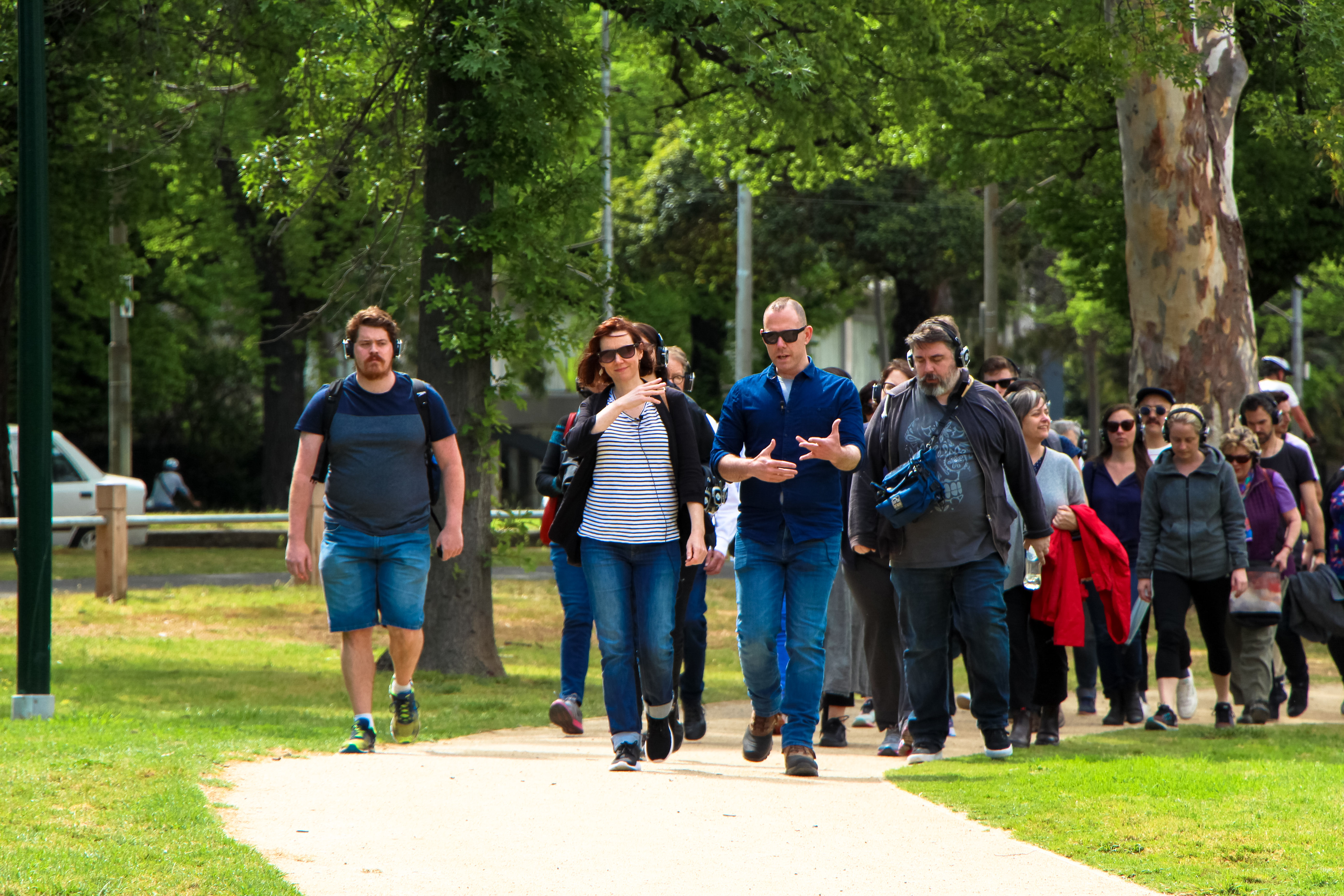 Photo of Ruth Quibell, Damon Young and an audience of walkers in Princes Park