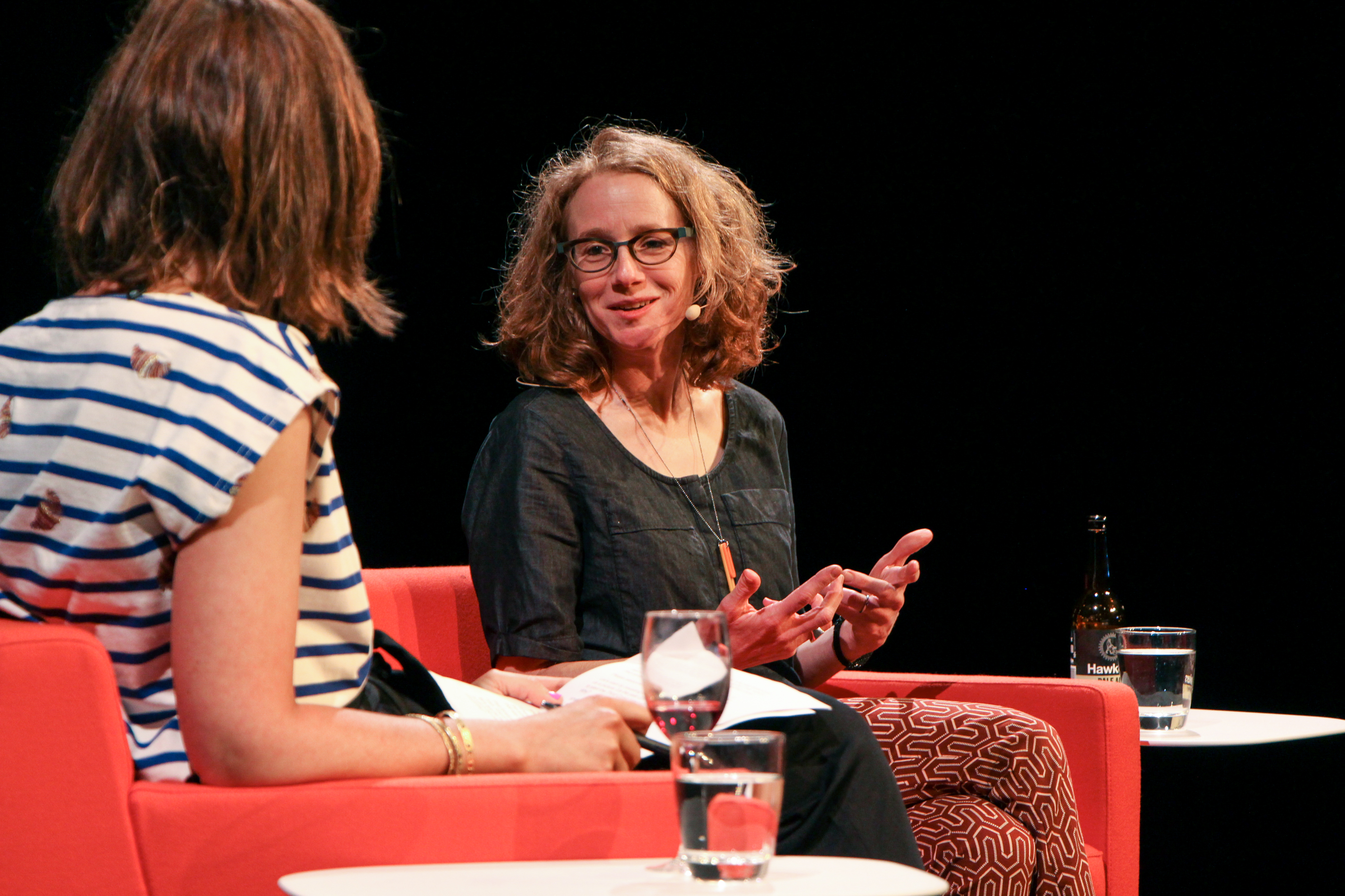 Photo of Julie Shapiro, talking to Sophie Black