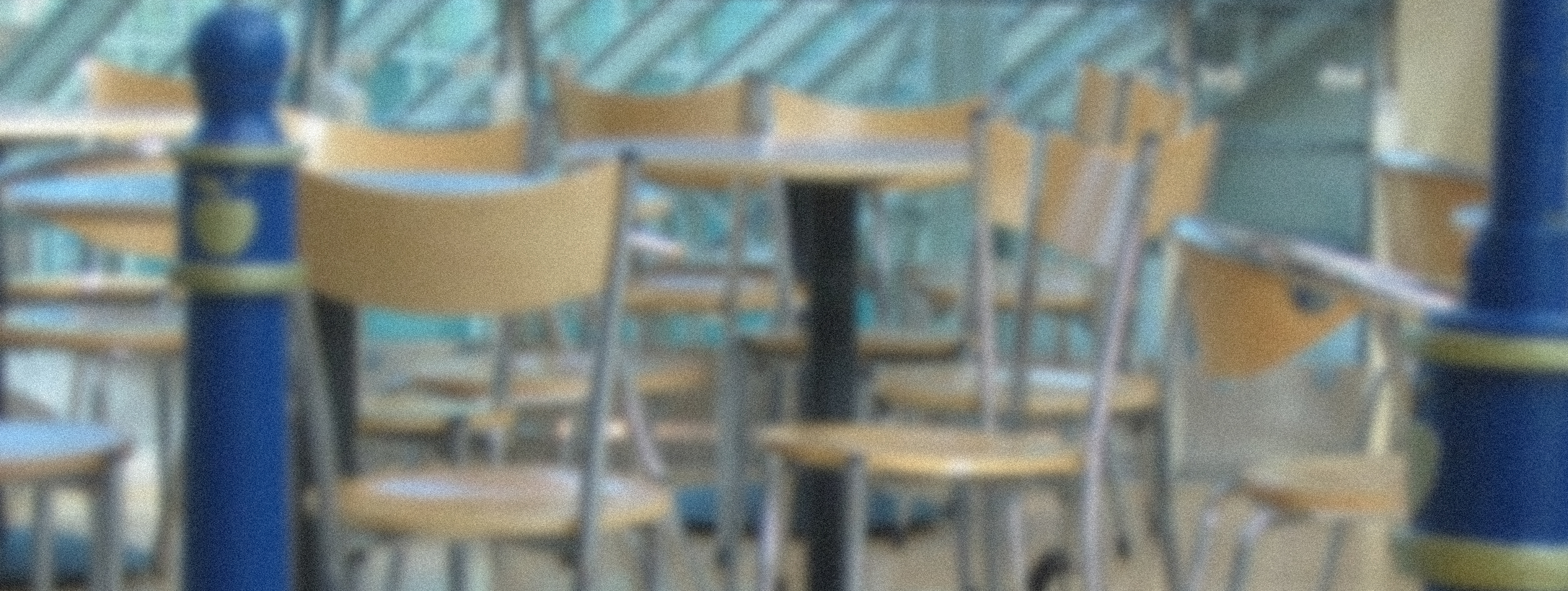 Photograph of an empty food court seating area