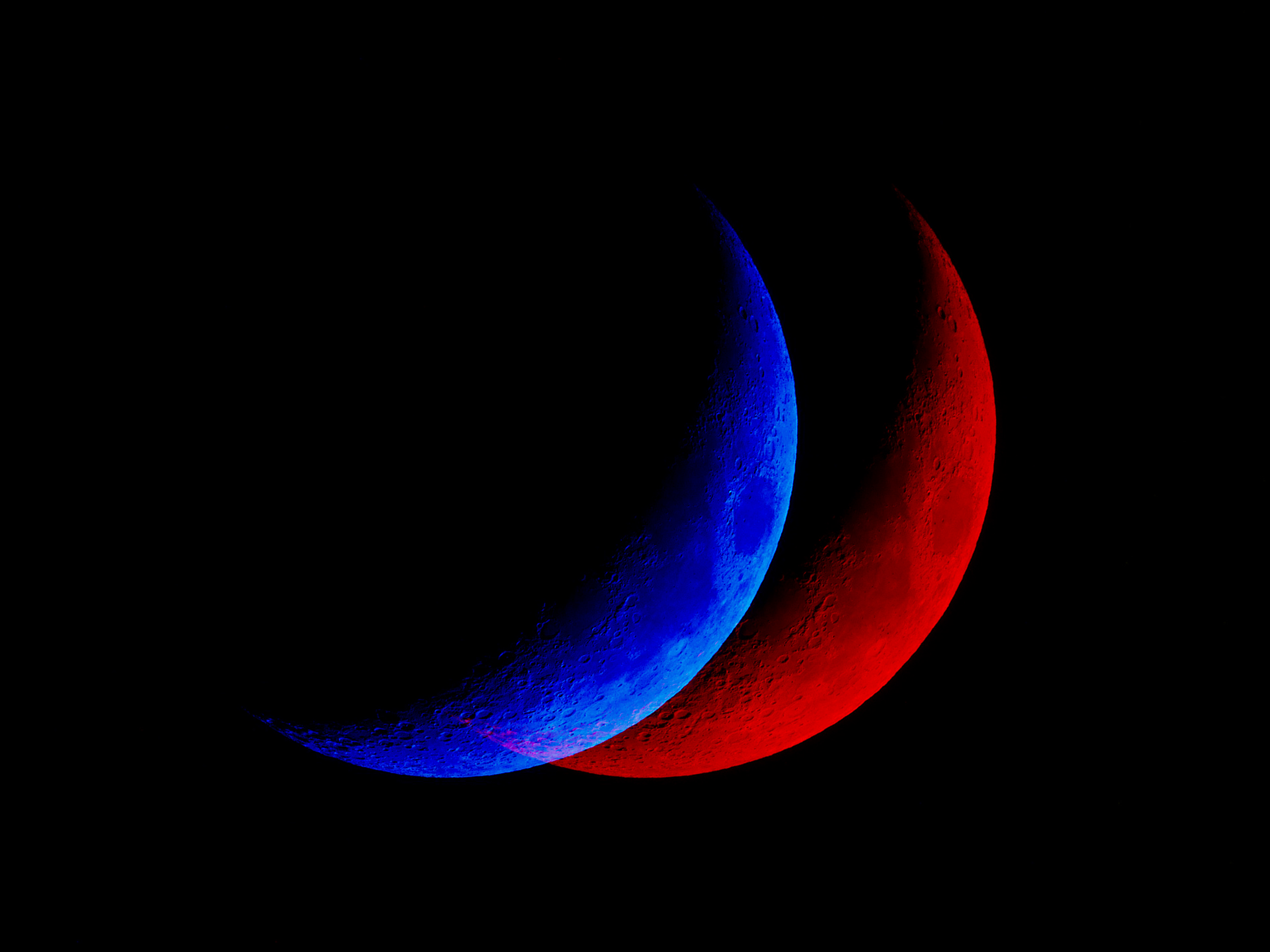 Abstract image of a blue shadowed moon, offset from a red shadowed moon