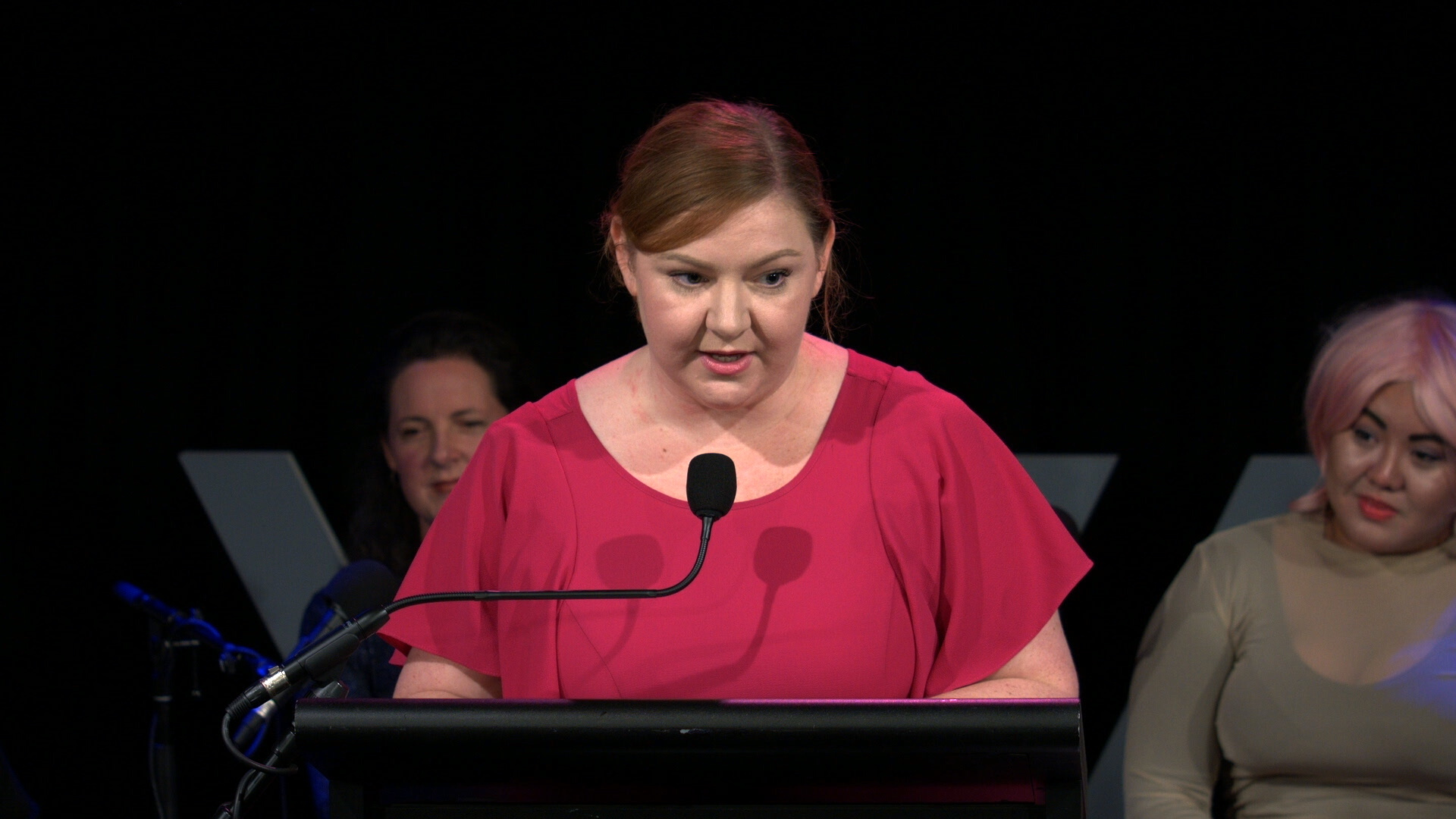 Photo of Jenna Guillaume speaking at the lectern