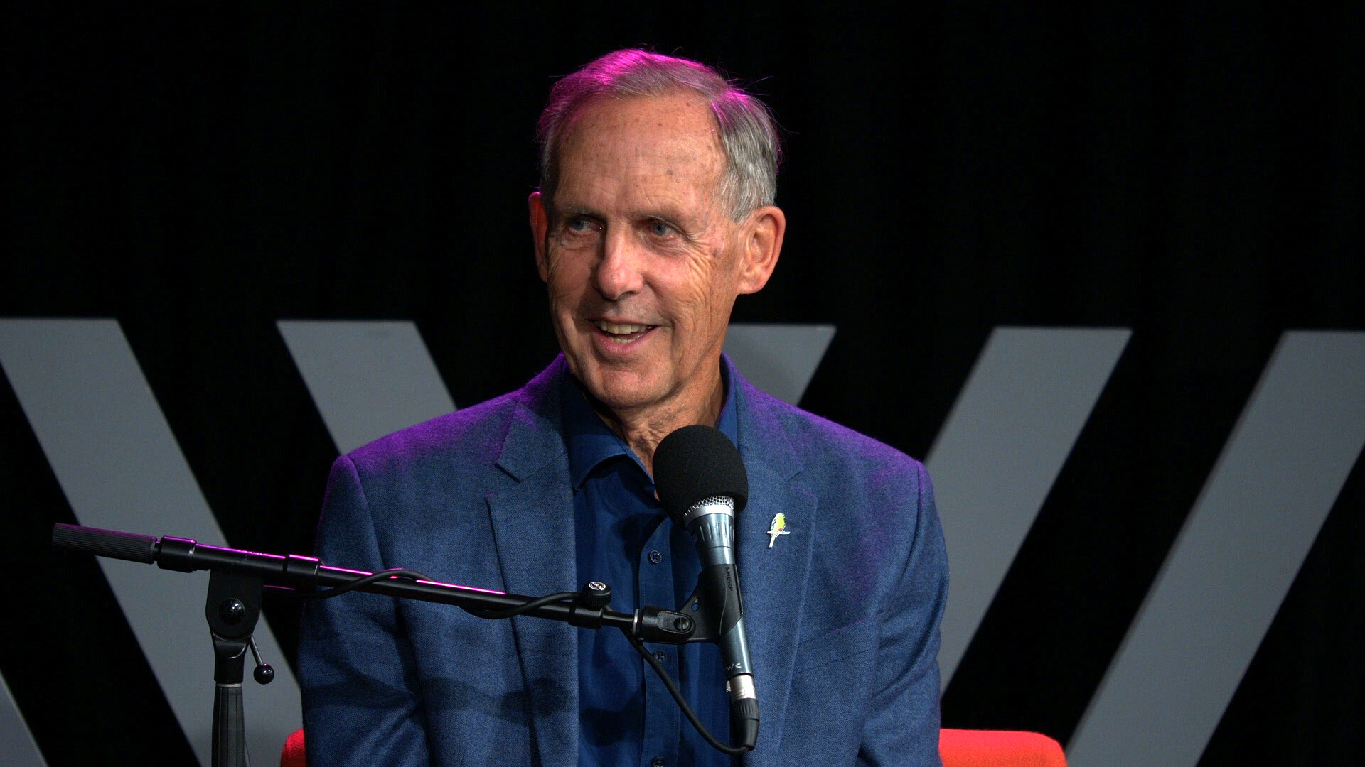Photo of Bob Brown, smiling, speaking into a microphone at the Wheeler Centre