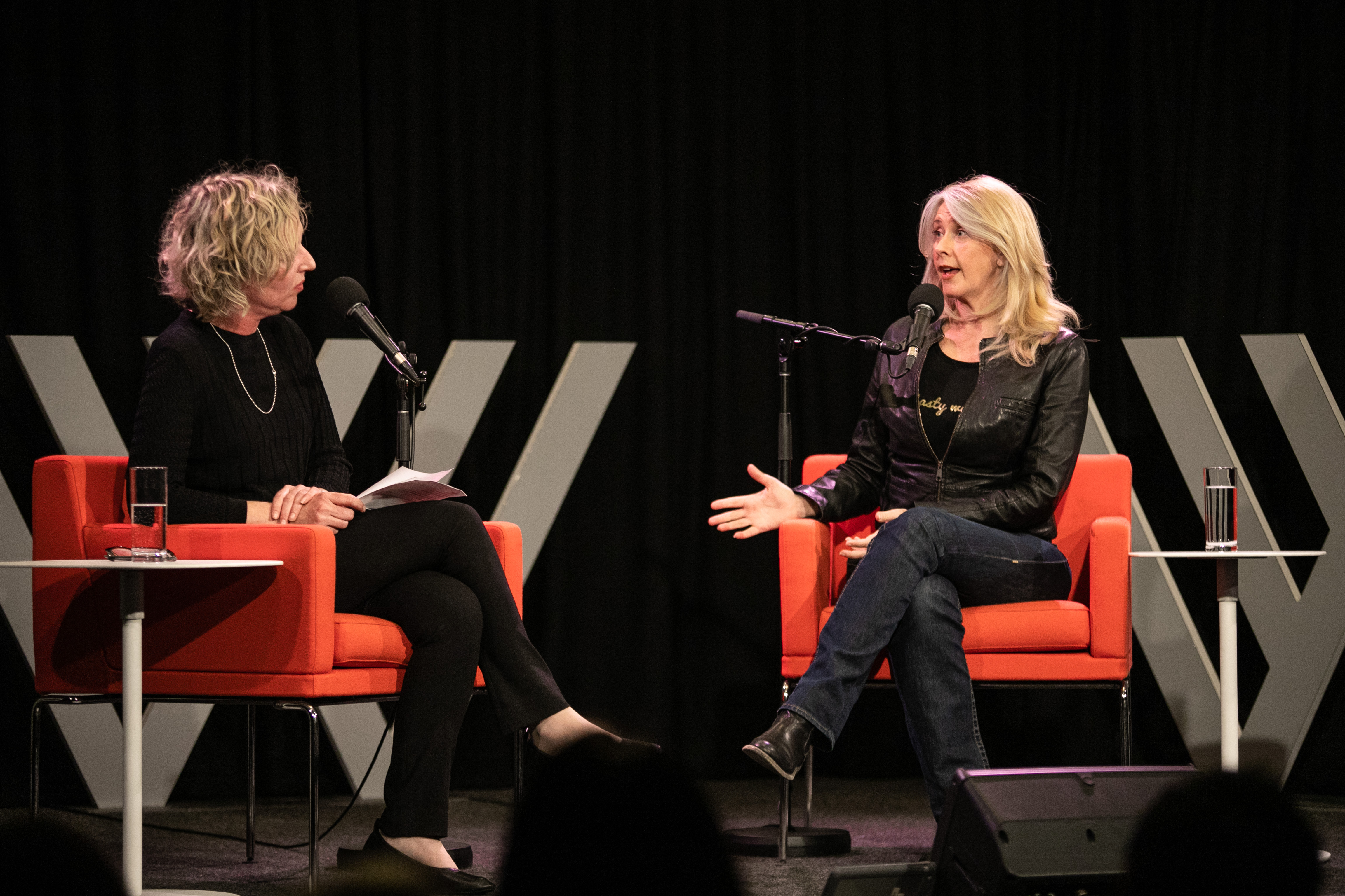 Photo of Sally Warhaft and Tracey Spicer, who is gesturing and speaking