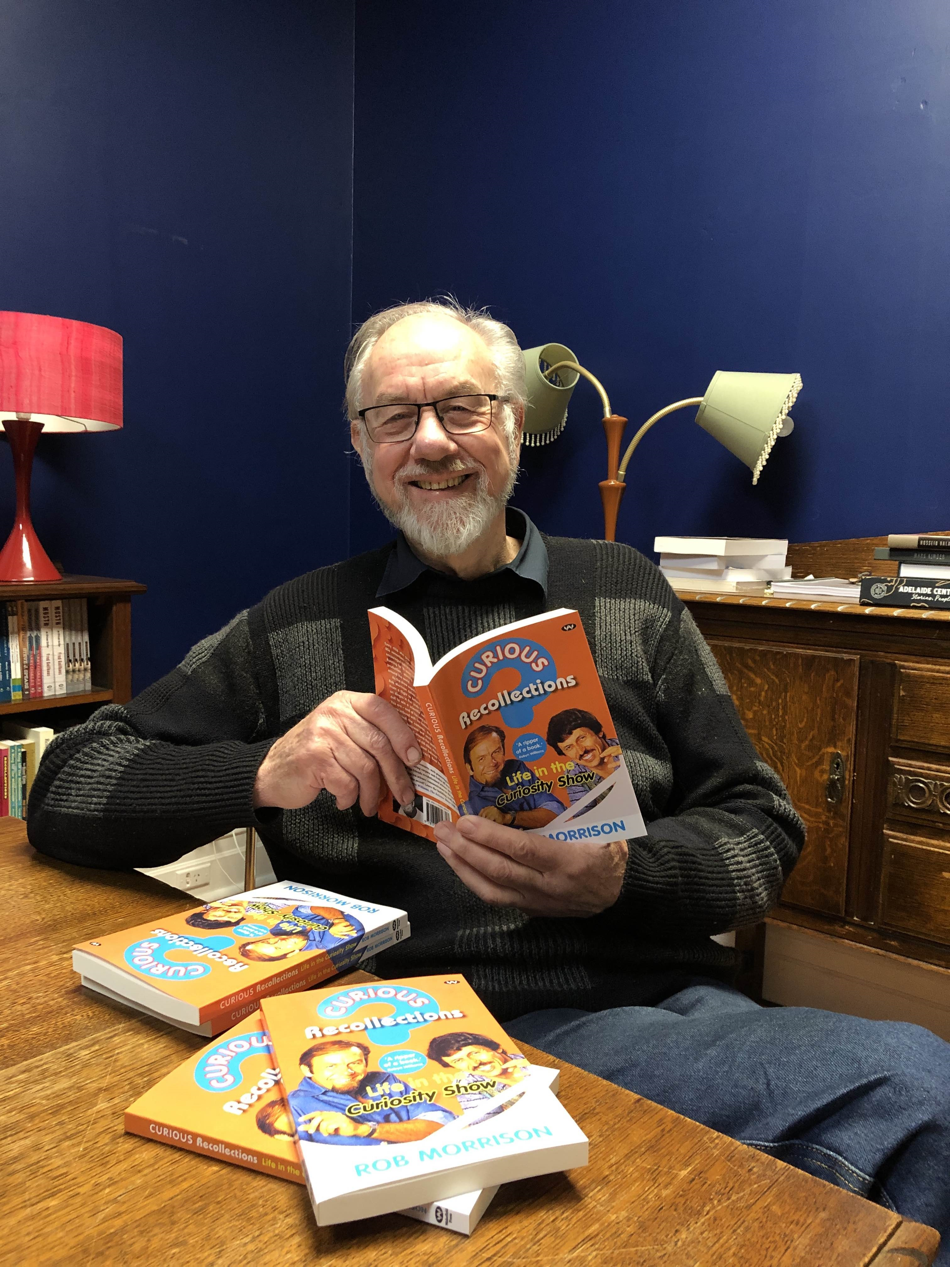 Photograph of Rob Morrison with some books