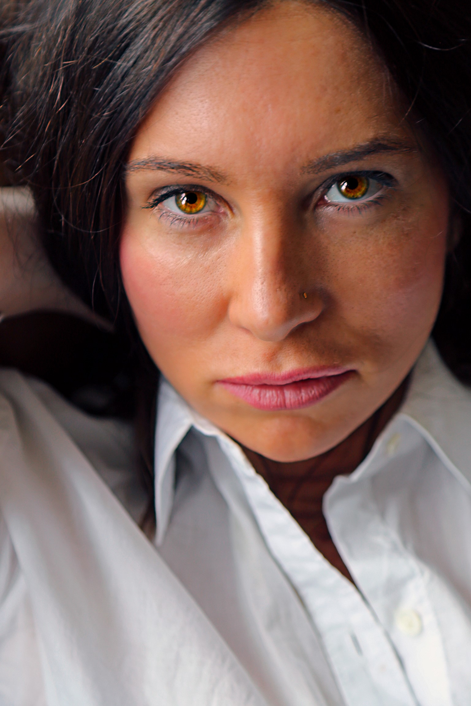 Photograph of Lisa Taddeo, wearing a white shirt, with brown hair, looking at the camera