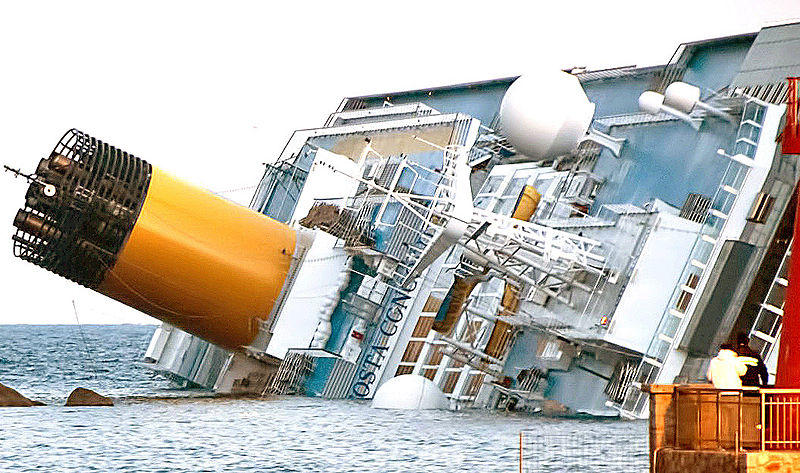 The listing Costa Concordia off Italy's Tuscan coast, via Roberto Vongher/Wikimedia Commons.