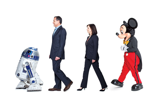 Photo from *Bloomerg Businessweek*. From left, R2-D2, Disney Chairman and CEO Robert Iger, Lucasfilm President Kathleen Kennedy, and Mickey Mouse.