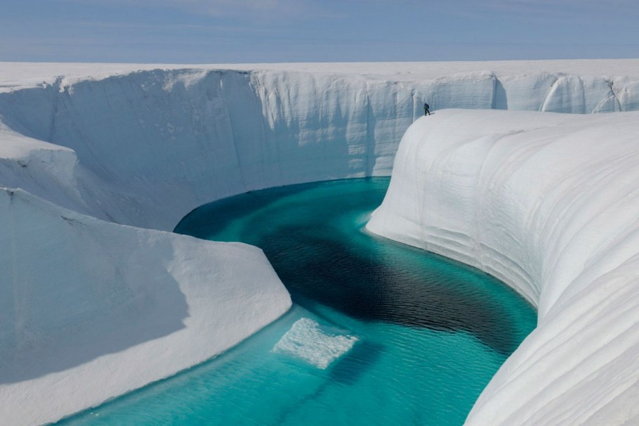 Greenland's Birthday Canyon, a meltwater channel around 150 feet deep. The black deposit at the bottom of the channel is cryoconite, a substance that speeds the melt.