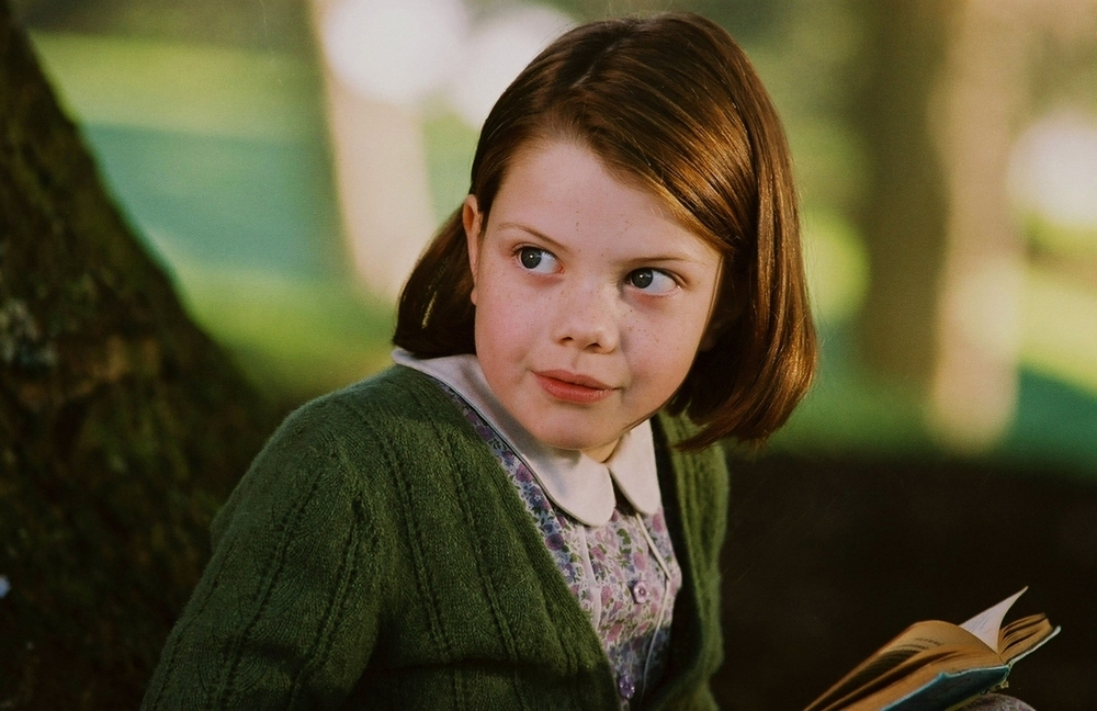 Georgie Henley as Lucy Pevensie in the 2005 film *The Chronicles of Narnia: The Lion, the Witch and the Wardrobe*.