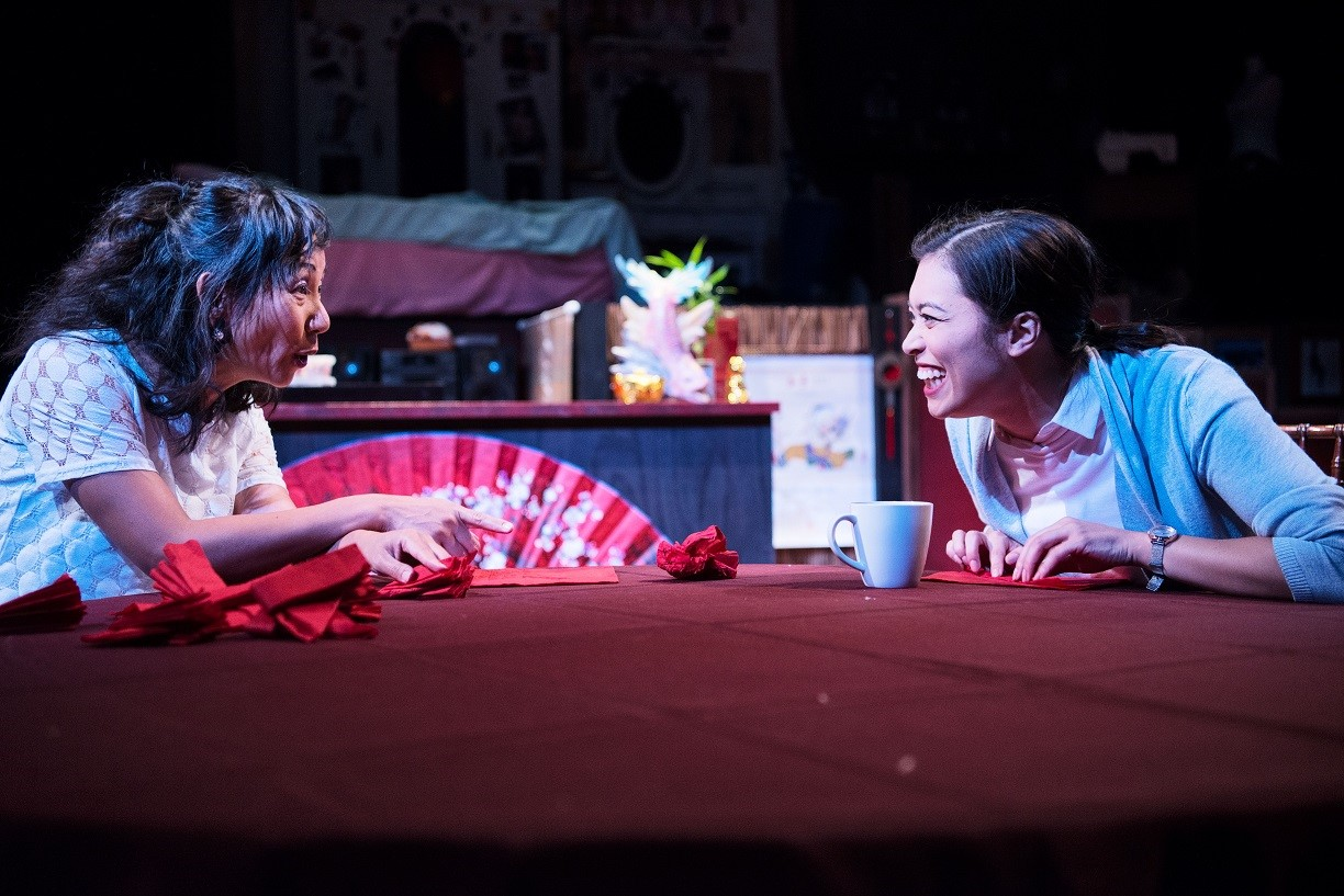Photo of Actors Hsiao-Ling Tang and Alex Lee in a scene from Michelle Law's play, Single Asian Female