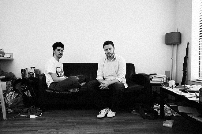 Amir Taaki, left, and Cody Wilson, in Wilson's Austin apartment. Julia Robinson/*Wired*.