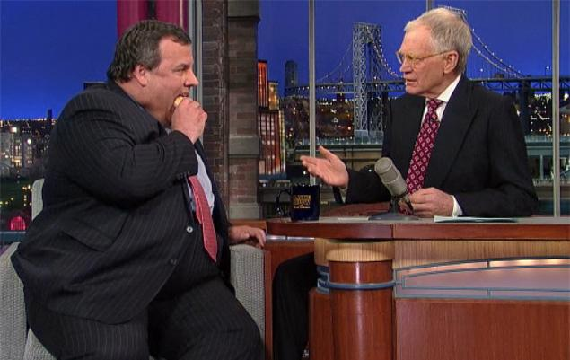 New Jersey Governor Chris Christie mocks himself by eating a donut on *Letterman*.