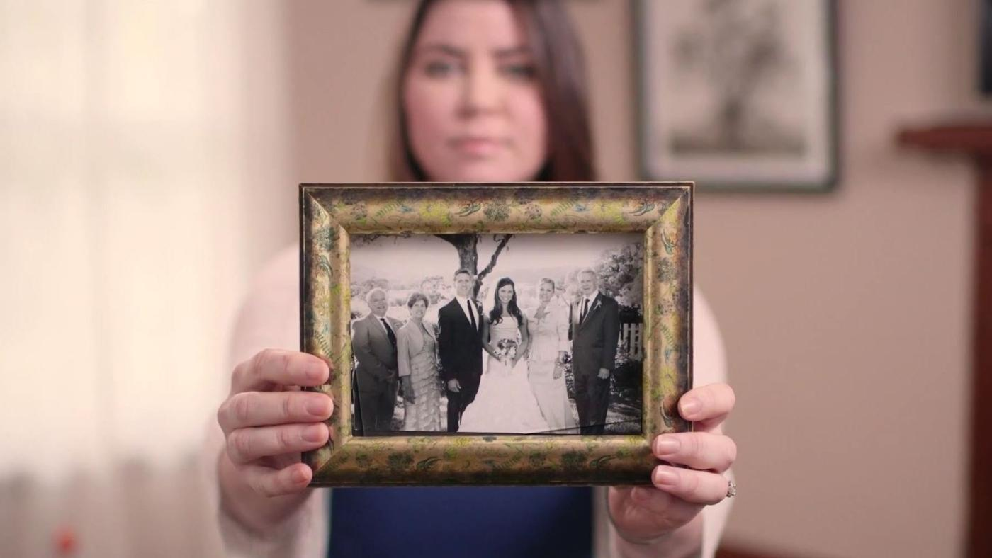 Brittany Maynard holds a framed photo from her wedding
