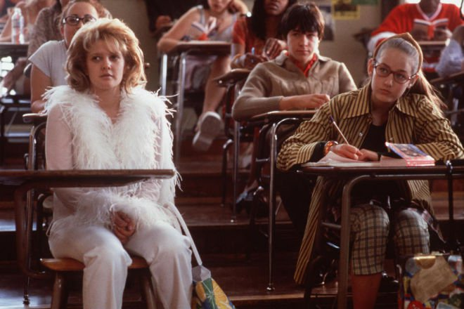 Drew Barrymore plays a journalist who goes undercover at a high school in *Never Been Kissed*, a film *Junkee* refers to.