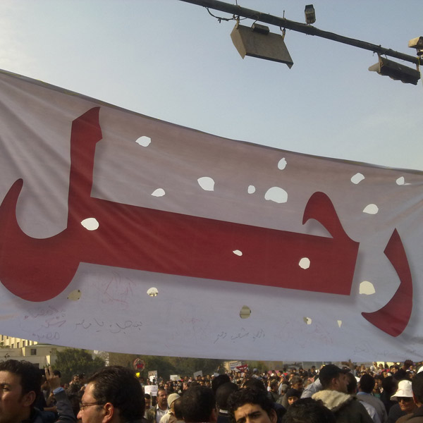 A banner that reads 'Leave!' during protests in Tahrir Square last month in Cairo. Image via WikiCommons