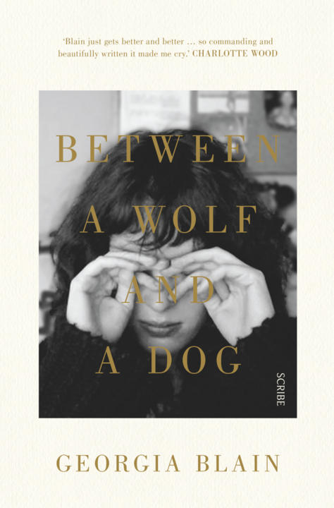 Cover image for Between a Wolf and a Dog