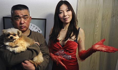 Japanese sex counsellor Ai Aoyama, with one of her clients and her dog Marilyn. Via the *Guardian*.