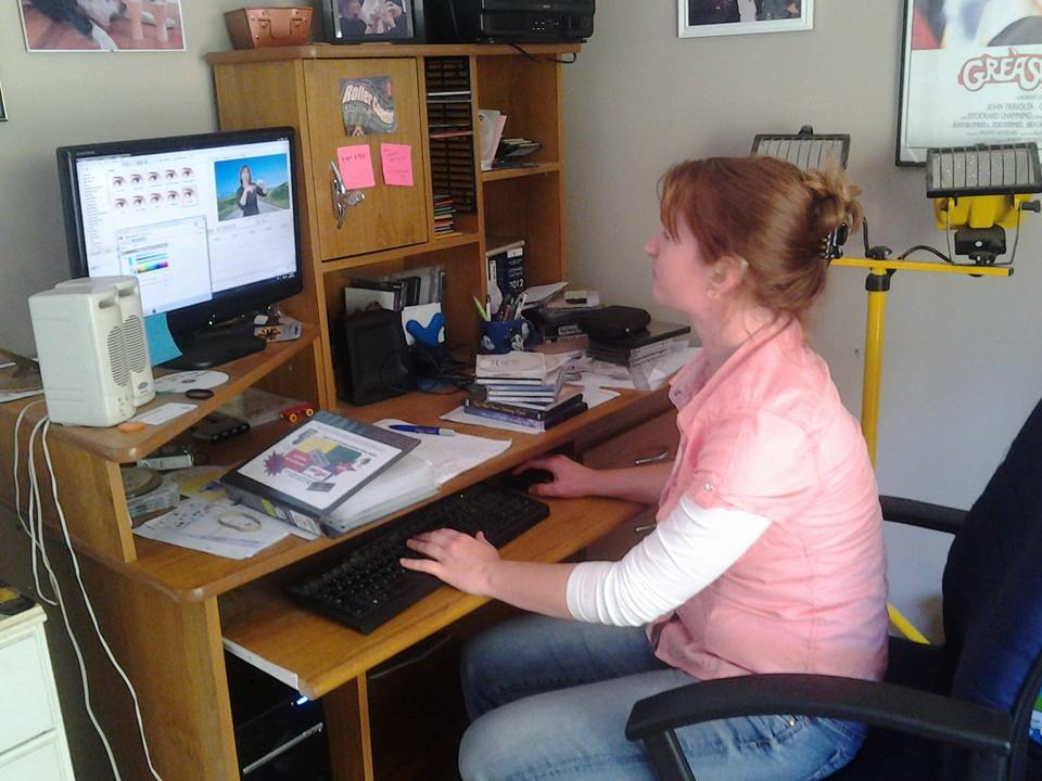 Image: Trudy Fraser at work, producing Auslan Storybooks videos