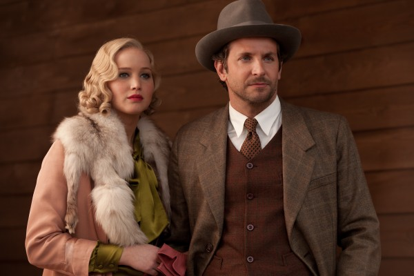 Bradley Cooper and Jennifer Lawrence star as Appalachian timber overlords in *Serena*.