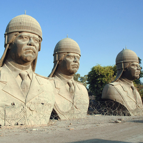Nine-metre bronze sculptures of Saddam Hussein in the grounds of the Republican Palace, Baghdad, 2005, by Kim Gordon, USDoD, via WikiCommons