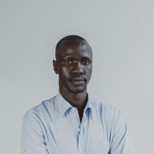 Portrait of Deng Adut with Ben Mckelvey