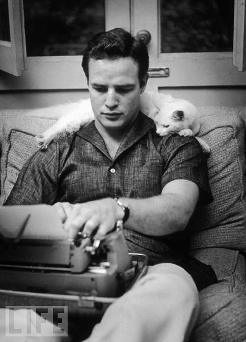 Marlon Brando, typing. He *could* have been writing his first book, but okay, we just like the picture.